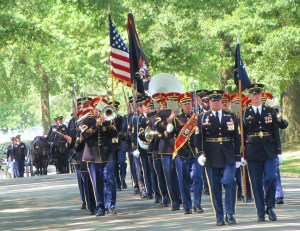 The Army's Old Guard escorts the caisson containing three fallen heroes' remains to their final resting place in Arlington National Cemetery.