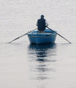 In Naples for a conference, I took an early morning walk and caught this image of a boatsman out fishing.