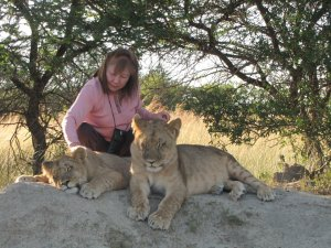 My wife Myung petting young lions at Antelope Park, near Harare, Zimbabwe.