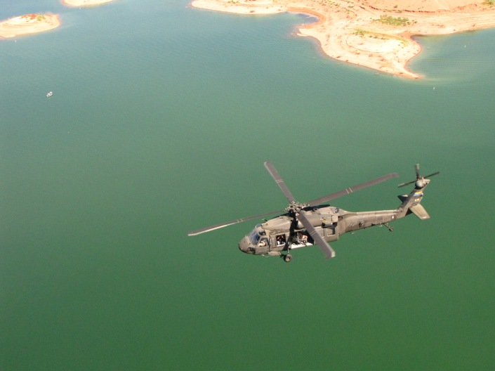 One doesn't normally associate water with green, but this northern Arizona lake, with a military rescue helicopter flying over it is a nice deep green color, don't you think?