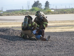 Simulated air crash casualty being treated.