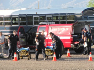 Local fire rescue personnel respond to simulated air crash at the air base.