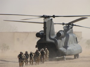 Colombian, Brazilian, and Chilean forces disembark from Chinook flown by Singaporean pilots.