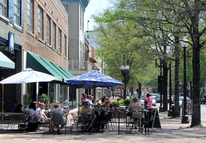 Sidewalk cafes and street musicians have replaced the dives of the past. It's not Fayette-nam anymore.