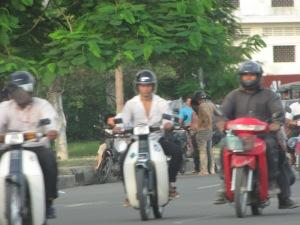 Cyclists in Phnom Penh, Cambodia.